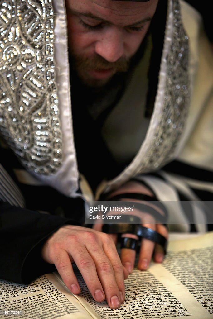 An ultraorthodox Jew follows the reading of the Scroll of Esther during Purim festival prayers at the Permishlan Chassidic synagogue on February 28...
