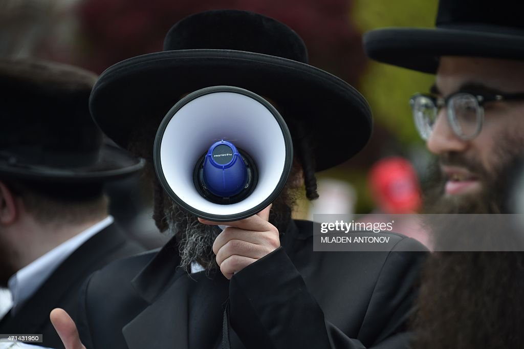An UltraOrthodox Jew shouts anti samesex marriages slogans outside the US Supreme Court on April 28 2015 in Washington DC AFP PHOTO / MLADEN ANTONOV