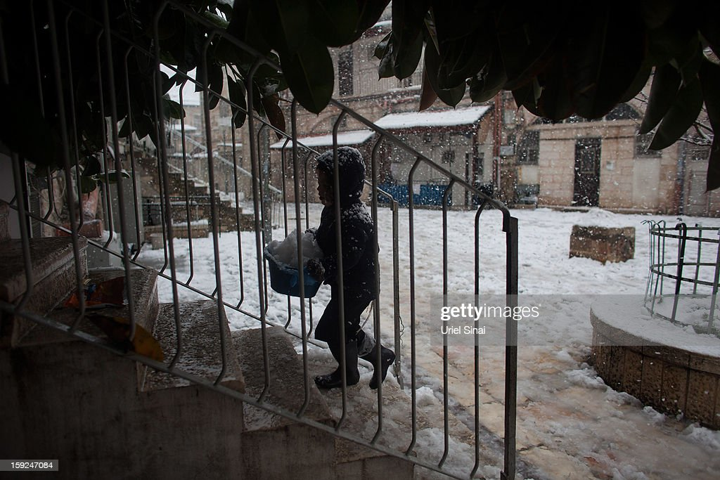 An Ultra-orthodox Jewish boy plays in the snow in the Mea Shearim religious neighborhood on January 10, 2013 in Jerusalem, Israel.