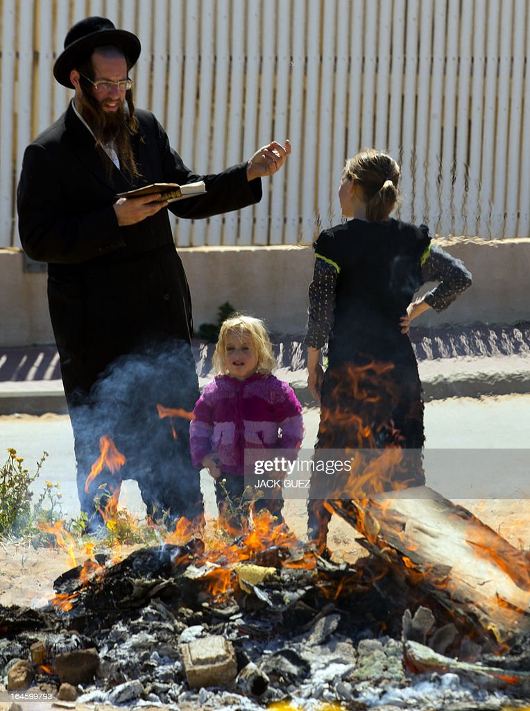 An Ultra-Orthodox Jewish family pray as leavened items are burnt in the final preparation before the start at sundown of the Jewish Passover holiday, in the Mediterranean coastal city of Netanya, central Israel, on March 25, 2013. All leavened food, such as bread, is forbidden to Jews during the week-long holiday, which to commemorate the Israelites' exodus from Egypt some 3,500 years ago. Due to the haste with which the Jews left Egypt, the bread they had prepared for the journey did not have time to rise. To commemorate their ancestors' plight, the religious avoid eating leavened food products throughout Passover.