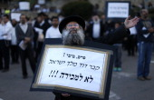 An UltraOrthodox Jewish man holds a placard reading in Hebrew 'Peres Bibi the David's tomb is not for sale' during a protest against Pope Francis'...