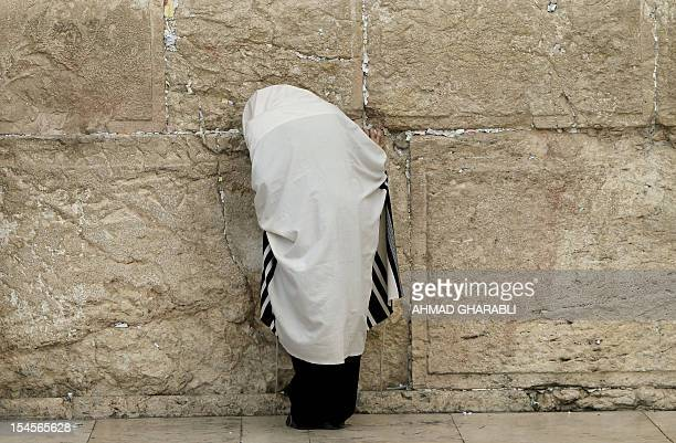 An ultraOrthodox Jewish man prays in front of the Western Wall Judaism's holiest prayer site in Jerusalem's Old City on October 22 2012 AFP...