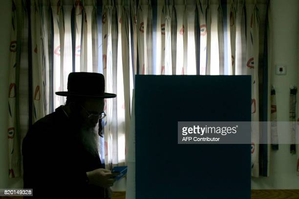 An UltraOrthodox Jewish man readies to fill his ballot at a polling station in the Mea Sharim religious Neighborhood of Jerusalem 28 March 2006...