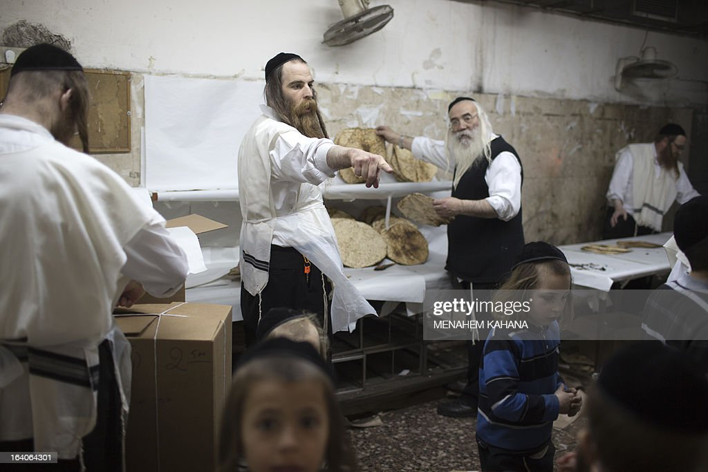 An Ultra-Orthodox Jewish man selects the Matzoth, or unleavened bread, after it was baked on March 19, 2013, in Jerusalem. Religious Jews throughout the world eat matzoth during the eight-day Pesach holiday (Passover), which begins on March 25, with the sunset to commemorate the Israelis' exodus from Egypt some 3,500 years ago and commemorate their ancestors' plight by refraining from eating leavened food products.