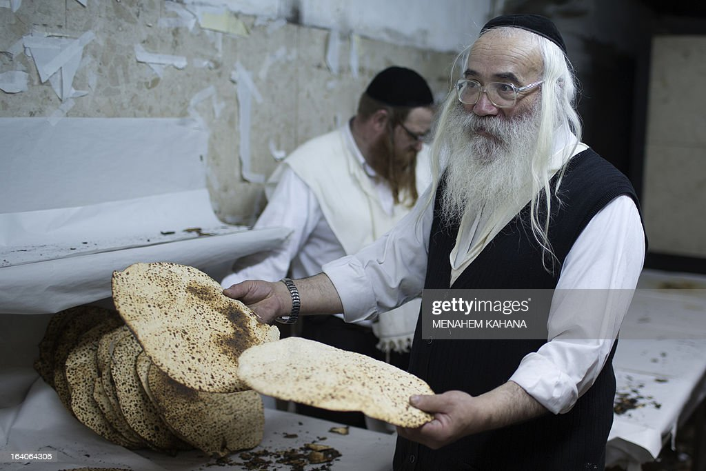 An Ultra-Orthodox Jewish man selects the Matzoth or unleavened bread after it was baked on March 19, 2013, in Jerusalem. Religious Jews throughout the world eat matzoth during the eight-day Pesach holiday (Passover), which begins on March 25, with the sunset to commemorate the Israelis' exodus from Egypt some 3,500 years ago and commemorate their ancestors' plight by refraining from eating leavened food products. AFP PHOTO/MENAHEM KAHANA
