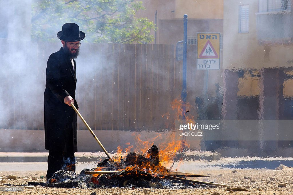 An Ultra-Orthodox Jewish man watches leavened items burn in the final preparation before the start at sundown of the Jewish Passover holiday, in the Mediterranean coastal city of Netanya, central Israel, on March 25, 2013. All leavened food, such as bread, is forbidden to Jews during the week-long holiday, which to commemorate the Israelites' exodus from Egypt some 3,500 years ago. Due to the haste with which the Jews left Egypt, the bread they had prepared for the journey did not have time to rise. To commemorate their ancestors' plight, the religious avoid eating leavened food products throughout Passover.