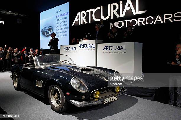 An ultrarare Ferrari 250 GT California SWB spider from the Baillon collection is displayed during the auction at Retromobile show by the Artcurial...