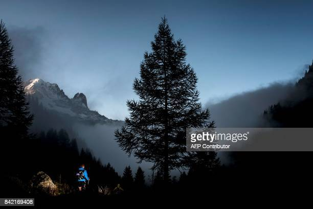 An Ultratrailer competes in Le Col des Montets on September 3 2017 near Chamonix during the 15th edition of the Mount Blanc Ultra Trail a 170 km race...