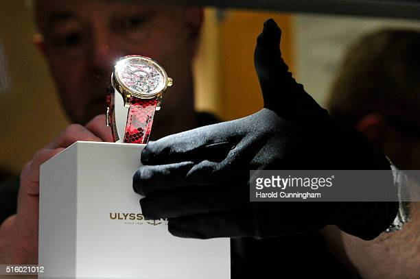 An Ulysse Nardin staff arranges a watch during Baselworld on March 16 2016 in Basel Switzerland Held annually Baselworld is the most important watch...