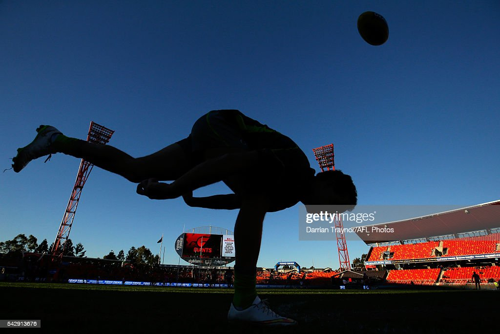 An umpire bounces a ball before the round 14 AFL match between the Greater Western Sydney Giants and the Carlton Blues at Spotless Stadium on June 25, 2016 in Sydney, Australia.