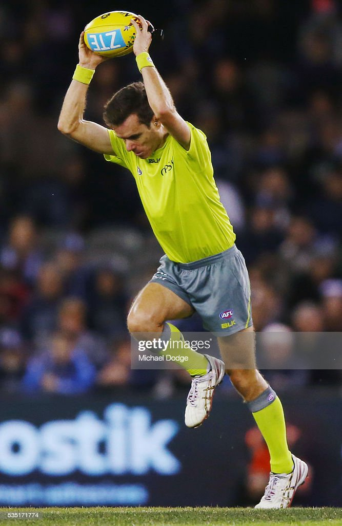 An umpire bounces the ball during the round 10 AFL match between the Carlton Blues and the Geelong Cats at Etihad Stadium on May 29, 2016 in Melbourne, Australia.