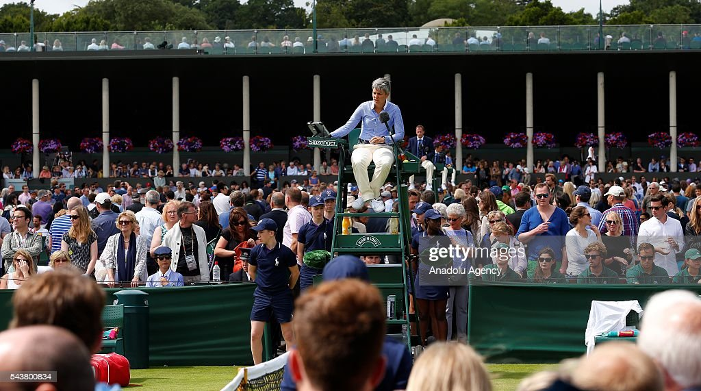 An umpire is seen during the tennis match between Marcos Baghdatis of Cyprus and John Isner of USA in the men's singles on day four of the 2016 Wimbledon Championships at the All England Lawn and Croquet Club in London, United Kingdom on June 30, 2016.