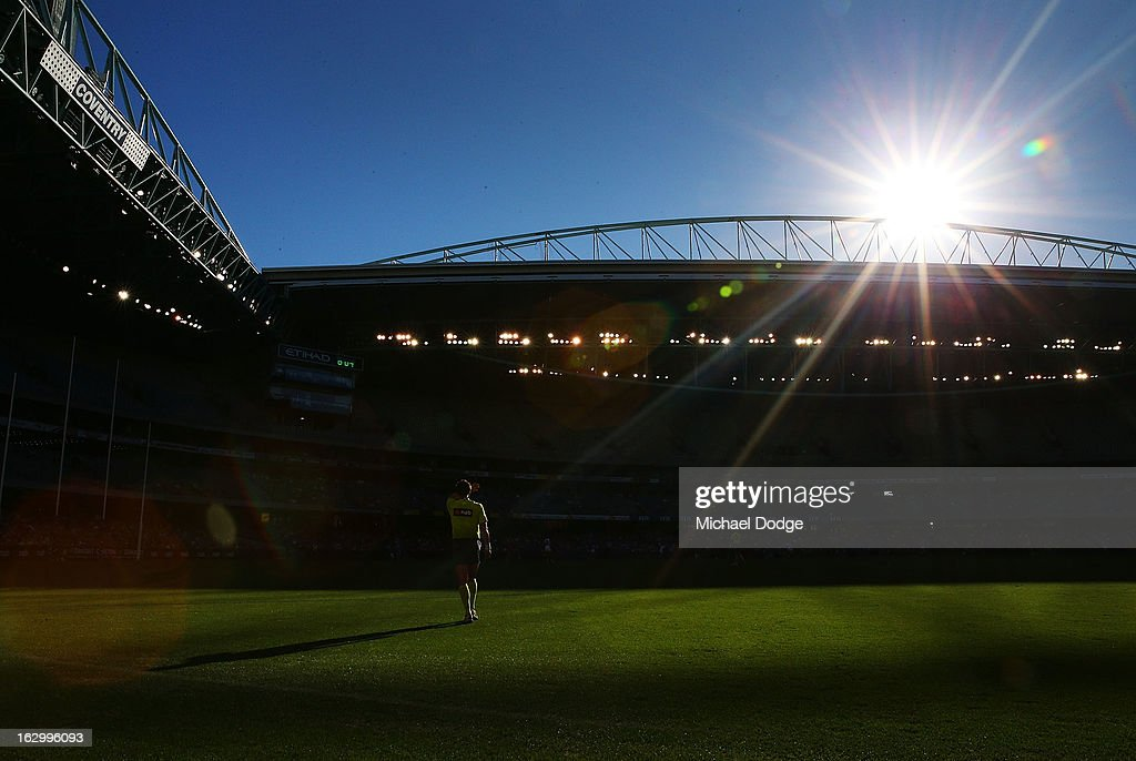 An umpire shields his face from the sun during the round two AFL NAB Cup match between the St Kilda Saints and the Sydney Swans at Etihad Stadium on March 3, 2013 in Melbourne, Australia.