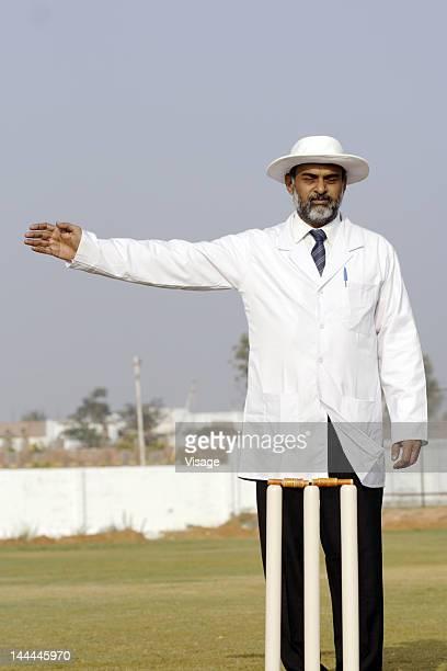 An umpire signaling a no ball