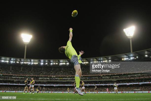 An umpire throws the ball in during the round one AFL match between the Carlton Blues and the Richmond Tigers at Melbourne Cricket Ground on March 23...