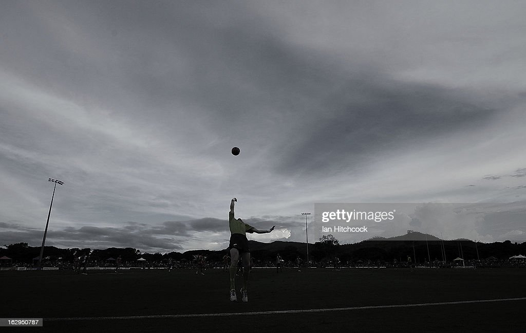 An umpire throws the ball into play during the round two AFL NAB Cup match between the Gold Coast Suns and the North Melbourne Kangaroos at Tony Ireland Stadium on March 2, 2013 in Townsville, Australia.