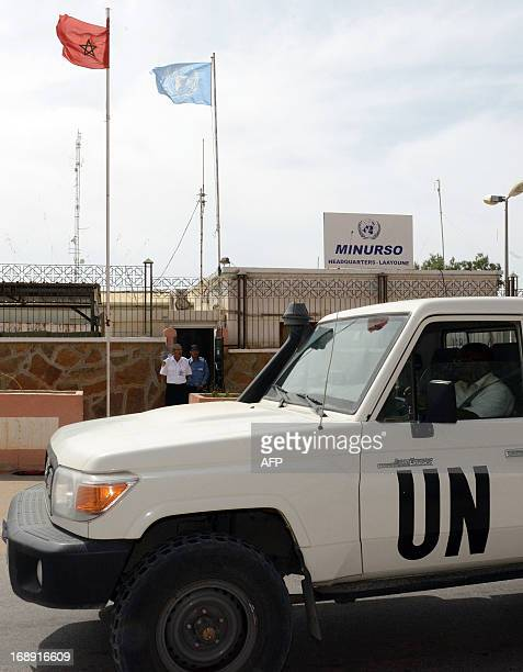 An UN vehicle drives past the headquarters of the United Nations Mission for the Referendum in Western Sahara on May 13 2013 in Laayoune the main...