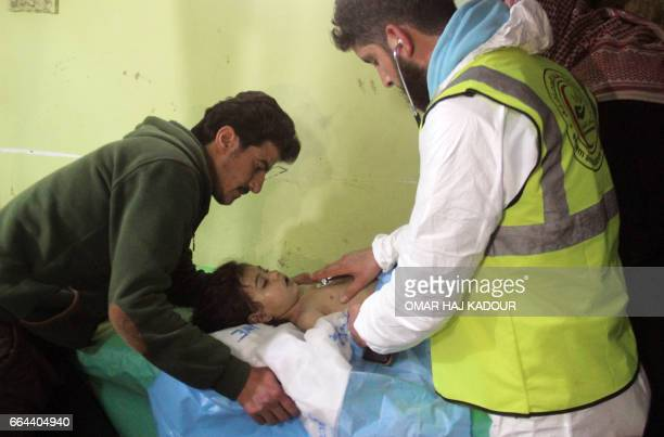 An unconscious Syrian child receives treatment at a hospital in Khan Sheikhun a rebelheld town in the northwestern Syrian Idlib province following a...