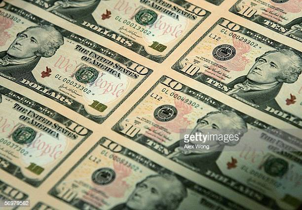 An uncut sheet of the redesigned $10 bill is seen after a news conference to commemorate the first day of circulation of the new notes at the...