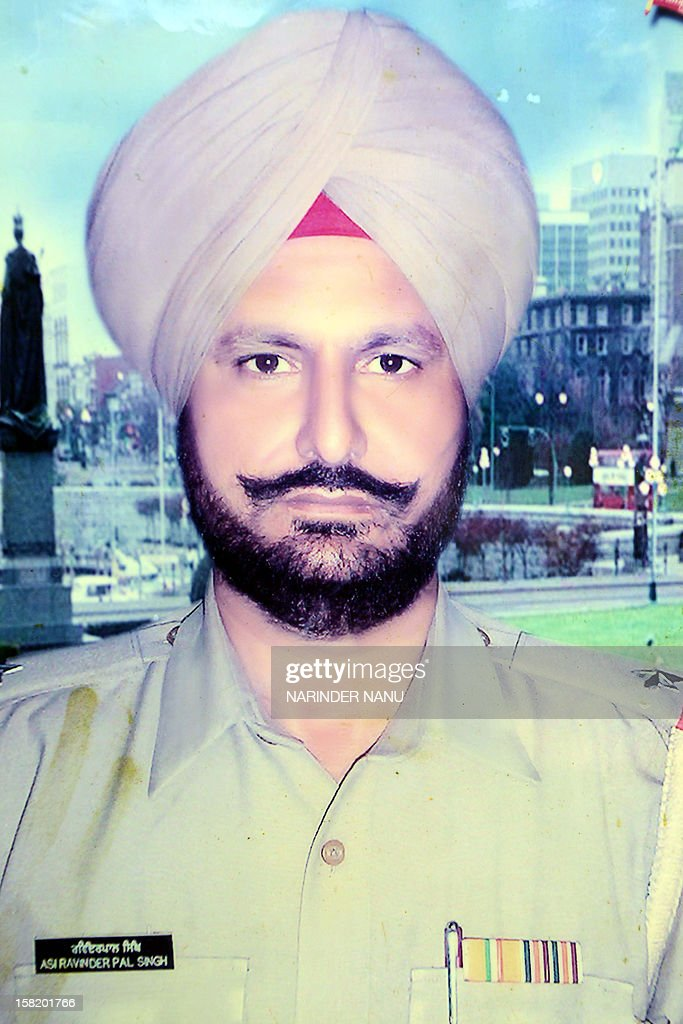 An undated family photograph of late Indian Punjab Police assistant sub-inspector Ravinder Pal Singh is shown to the media at the family residence in Rampura village on the outskirts of Amritsar on December 11, 2012. The leader of Punjab's ruling Shiromani Akali Dal and an accomplice were arrested on December 6, 2012, for allegedly killing the police official Ravinder Pal Singh.