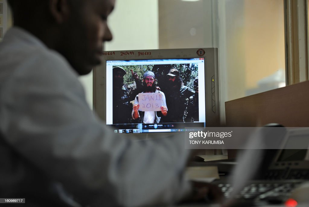 An undated photo of Abu Mansoor al-Amriki [C] aka 'the American' taken at an undisclosed location is seen on a computer screen in Nairobi, Kenya on February 07, 2013. Once his reputation was of a feared fighter, an American born extremist who left small town Alabama to wage war alongside Al-Qaeda linked Somali Islamists and who called on other foreigners to join. Today, Omar Hamami -- better known as Abu Mansoor al-Amriki or 'the American' -- has split from the insurgents who want to kill him. He spends his days firing off insults of corruption and abuse at his former Shebab colleagues, even referring to himself as the 'former poster boy' of the group. AFP PHOTO/Tony KARUMBA