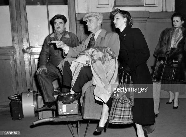 An undated photo shows US actor and film director Buster Keaton and his wife Eleanor Norris in a Parisian train station AFP PHOTO