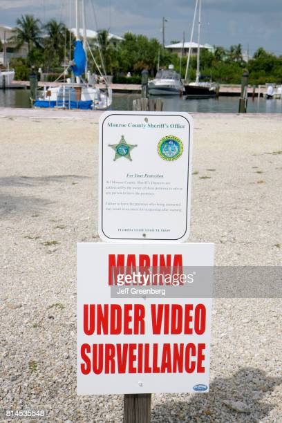 An under video surveillance sign at a private marina in Islamorada