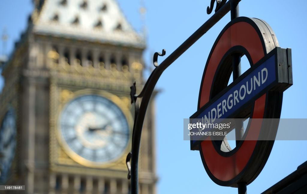 An underground sign is pictured next to the 'Big Ben' clock Tower on July 24, 2012, in London three days before the start of the London 2012 Olympic Games. Seven years in the making, costing £9.3 billion ($14.5 billion) and featuring 10,490 athletes, the London Olympics opens on July 27 with 302 gold medals to be won and hard-fought reputations at stake. AFP PHOTO / JOHANNES EISELE