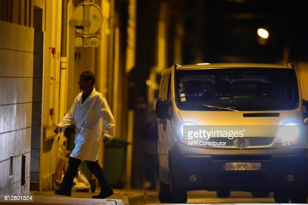An undertaker arrives with a hearse at the house of late French magistrate JeanMichel Lambert who was found dead at his home on July 11 in Le Mans...