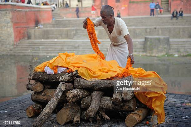 An undertaker performs during a cremation ceremony at Pashupati