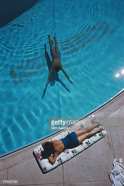 An underwater swimmer and a sunbather at Lake Tahoe 1959 The line on the bottom of the pool marks the state line between Nevada and California