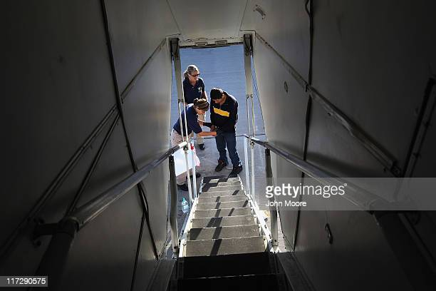 An undocumented Guatemalan immigrant chained for being charged as a criminal is checked before boarding a deportation flight to Guatemala City...