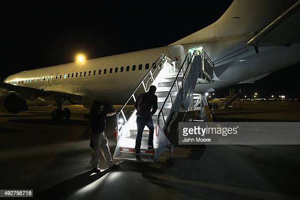 An undocumented immigrant boards an Immigration and Customs Enforcement charter jet early on October 15 2015 in Mesa Arizona The immigrants were to...