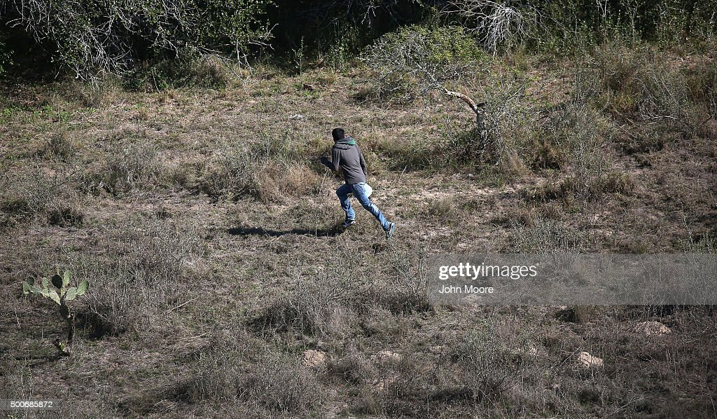 An undocumented immigrant runs from U.S. Border Patrol agents on December 9, 2015 near McAllen, Texas. Border security remains a key issue in the Presidential campaign.