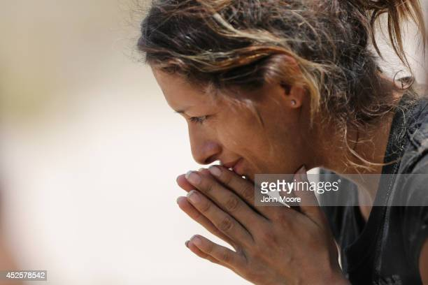 An undocumented immigrant sits after being detained by US Border Patrol agents some 60 miles north of the US Mexico border on July 23 2014 near...