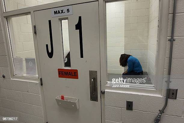 An undocumented Mexican immigrant waits to be deported from the Immigration and Customs Enforcement center on April 28 2010 in Phoenix Arizona Across...