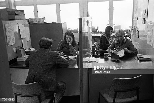 An unemployed man is interviewed at the Elephant and Castle Labour Exchange in South London 1976