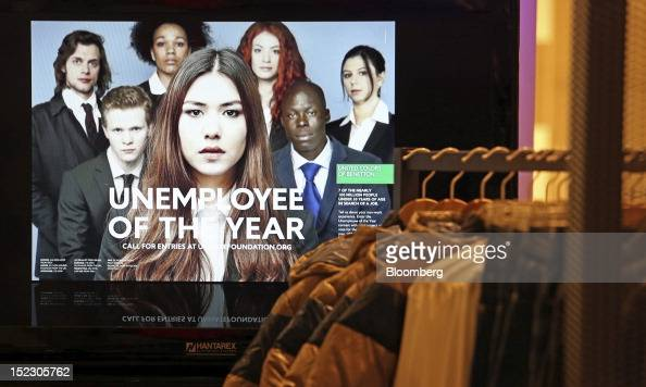 An 'Unemployee of the Year' advertising photograph is seen on a television screen inside the Benetton Group SpA store on Brompton Road in London UK...