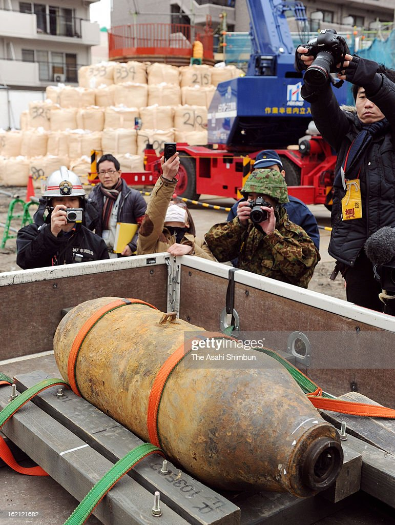 An unexploded bomb is carried after defused by Japan's Ground Self-Defense Force on February 17, 2013 in Kobe, Hyogo, Japan. The 250 kilograms U.S. bomb is thought to have dropped during the WWII, 7,100 residents in 300 meters radius evacuated.