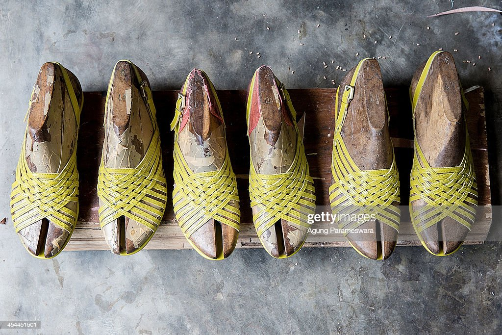 An unfinished high heels are seen at Niluh Djelantik atelier on November 12, 2013 in Canggu Village, Bali, Indonesia. Niluh Djelantik (formerly called Nilou), the hand made high end leather shoe, is produced by Balinese shoe lover and designer Ni Luh Ayu Pertami with 40 shoes designers and workers in a small atelier at Canggu Village. This brand signature by a unique engraving and designed to be comfortable high heels or wedges with elegan touch. Celebrities like Cate Blanchett, Uma Thurman,Julia Roberts ,Paris Hilton, Cameron Diaz and American top model Gisele Bundchen have been known to purchase Niluh Djelantik beautiful shoes and sandals.