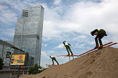 An unfinished public sculpture of ski jumpers sits during construction near the RiztCarlton luxury hotel operated by RitzCarlton Hotel Co in Almaty...