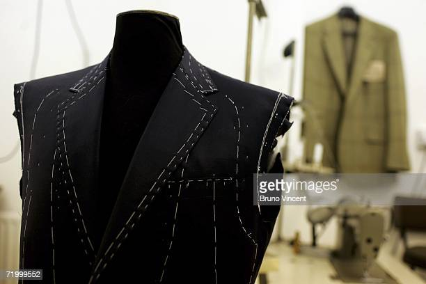 An unfinished suit hang from a tailors dummy in Huntsman tailors on August 14 2006 in London England With the commercial expansion of nearby tourist...