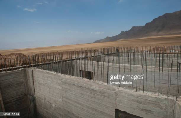 An unfinished water tank sits on the edge of the mostly abandoned land allocation settlement of AliceGhan about 30 miles outside of Kabul Afghanistan...