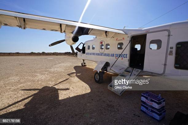 An UNHAS plane in Dinsoor in central Somalia UNHAS is a service critical to field assessments for both security and distribution as well moving...
