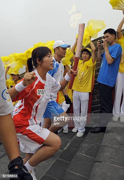 An unidentifed torchbearer carries the flame along a section of the Great Wall in Badaling outside Beijing on August 07 2008 a day before the start...