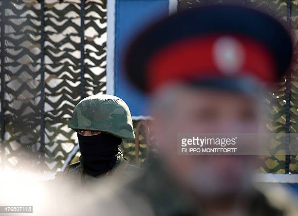 An unidentified armed man in uniform stands guard outside the headquarters of the Ukrainian Navy in Sevastopol on March 3 2014 Russian forces have...