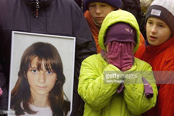 An unidentified child weeps during the funeral of Christina Kurbatova at the Moscow Vagankovsky cemetery October 30 2002 in Moscow Russia Kurbatova...