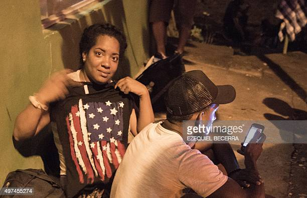 An unidentified Cuban woman displays an American flag in Penas Blancas Guanacaste Costa Rica on the border with Nicaragua on November 16 2015 A surge...