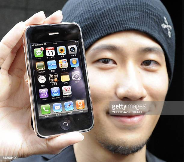 An unidentified customer shows Apple's new 3G iPhone mobile handset at a Softbank shop in Tokyo on July 11 2008 Over 1000 people many queuing through...