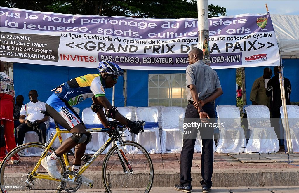 An unidentified cyclist warms up before the start on December 22, 2012 Kinshasa. The cycling federation of the Democratic Republic of Congo arranged a cycle race for peace attended by riders of the five regions in the Gombe district of Kinshasa. AFP PHOTO/Junior D.Kannah